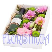 Box with flowers and wine